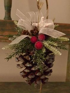 Beautiful Florida pine cone measures 6 inches from top of bow to bottom of pinecone. It is embellished with glitter on tips of petals, faux greenery, frosted cr Christmas Pine Cones, Christmas Ornament Crafts, Rustic Christmas, Christmas Projects, Handmade Christmas, Holiday Crafts, Christmas Holidays, Pinecone Ornaments, Christmas Carol