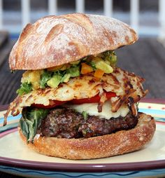 The Big Bad Wolf Burger - a 1/2 pound burger with basil, cilantro, oven roasted garlic and blue cheese chunks, topped with hash browns, spicy mayo and guacamole