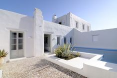Located in the midst of a protected natural preserve on the south coast of the island of Paros, this villa is truly a gem within THE LUXURIANS Greek Villas And Luxury Villas In Greece, Paros Island, Fruit Trees, Acre, Scenery, Greek, House Styles, Aromatic Herbs, Outdoor Decor