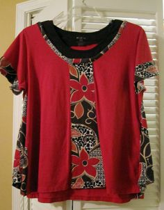 Bits of three t-shirts combined into a refashioned tunic.