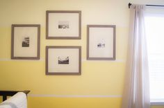 Yellow ombre walls + simple gallery wall