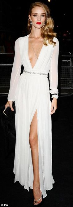 Dramatic entrance: The 24-year-old dress's slashed down to her waist for maximum impact and given the guest list which included the likes of Kate Moss and Georgia May Jagger, there was stiff competition to steal the spotlight