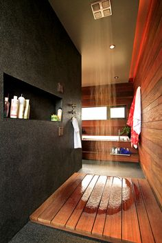 One of the coolest showers ever - The rain shower falls down to an ipe platform. The rest of the floor is Peppletec, often used for swimming...