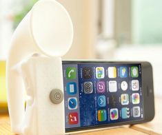 The iPhone speaker amplifier stand is a device that attaches to your iPhone and boosts the sound levels by 13 decibels without requiring any battery use, just good old fashioned acoustical science. It also doubles as phone stand so you can watch movies and shows.