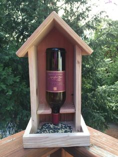Beautiful redwood & wine bottle bird feeder. One of a kind made of hand selected redwood with colorful striations. The redwood is untreated and will weather beautifully over time. Birds will love it! I stock a large variety of wine bottles (Thank you National Hotels Stanleys for providing me with bottles)! If you have a favorite, Ill check if its one I have. Otherwise I will chose one that looks the best against the redwood. -OR- You can chose a glass etched wine bottle with Grapes, Butte...