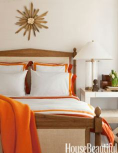3a60f65a2160b Fireplace Living Room Guest Bedroom Orange bedding accents brighten a white  guest room. Autumn Arslanian · Wats House