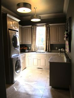 Goregeous laundry and mud room! I want this exact room.. so much space... laundry sink, folding area and tons of storage!