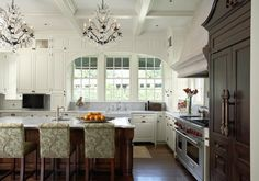 Chandeliers and refrigerator make this one glamorous kitchen. Literally my dream kitchen. All the colors i want and everything. Someday :)