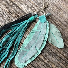 "Handbag Zipper Charm - Turquoise Suede Leather Bag Jewelry - Key Chain - FOB - Feathers - Boho - Tassel - Bohemian - Rustic - Stacy Leigh Bohemian bag embellishment with 2 full, suede leather feathers and 9"" long tassel fringe. The hook is small and will attach to a zipper tongue. It is"