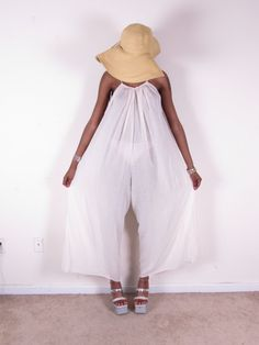 How cool is this! Really feeling the sheer palazzo trend...perfect for hot summer night! Amazing wide leg palazzo vintage cream sheer cotton gauze summer pants romper jumpsuit ONE SIZE. $70.00, via Etsy.