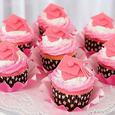 Spoil them with A+ grad cap and polka dot cupcakes! Just start with the polka dot baking cups, white icing, and pink sprinkles. Use pink fondant squares, strips and dots to assemble the hats, and place the cupcake on a large wave baking cup.