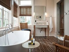 The en-suite bathrooms feature freestanding tubs. New Orleans Hotels, New Orleans Tourism, Chloe, Orange Leather Sofas, Pool Shade, Private Dining Room, Dark Wood Floors, Tall Ceilings, Hotel Interiors