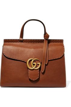 Tan leather (Calf) Push lock-fastening front flap Comes with dust bag Weighs approximately 2.2lbs/ 1kg Made in Italy