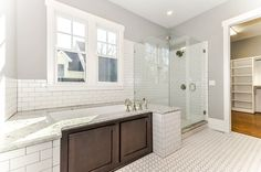 Master bath.. too much white for me. I will add a more natural look with earth tones. #craftsman #masterbath