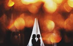 through lights, at a silhouetted couple