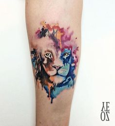 Watercolor lion forearm piece by Yeliz Ozcan.  http://tattooideas247.com/watercolor-lion/