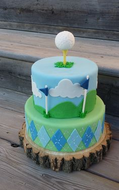 This golf-themed cake is outfitted with an argyle base tier and a golf ball topper all teed up and ready to go! Fore!