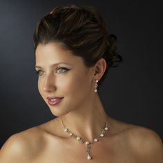 Antique Silver Diamond White Pearl Bridal Jewelry Set $156.99 StressAwayBridalShop.com This gorgeous floral silver plated design necklace encrusted with clear cut rhinestones features beautiful pearls. This is a great addition to any bridal ensemble. #jewelry #jewellery #shop