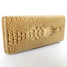 BEAUTIFUL CROCODILE PATTERN CLUTCH WALLET IN BEIGE COLOR MADE FROM COWHIDE by HelloThailand. $29.55. BEAUTIFUL CROCODILE PATTERN CLUTCH WALLET IN BEIGE COLOR MADE FROM COWHIDE  THIS  CLUCTH WALLET IN STYLE HEAD CROCODILE LOOK AS REAL CROCODILE BUT THIS CLUCTH WALLET MADE FROM COWHIDE