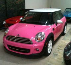 pink Mini cooper<3 need one of these for the driveway!