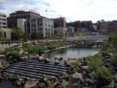 Since breaking ground in December, 2010, the Saw Mill River daylighting project has created 13,775 square feet of aquatic habitat in downtown Yonkers, New York. Future redevelopment phases include a pedestrian courtyard and additional daylighting close to the purple billboard seen in the distance. Photo: Zach Youngerman