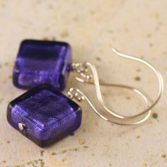 Purple glass earrings featuring Acai purple colored Murano Venetian glass. The Acai purple glass beads are 11x5mm flat squares and dangle freely on light weight sterling silver earwires and measure ab