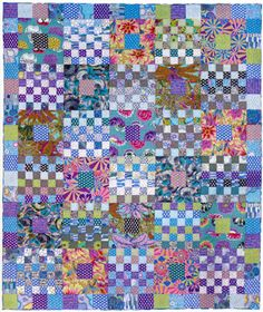 Grey gridlock quilt, Kaffe Fassett / Liza Prior Lucy design, spotted at The Cotton Patch (UK). Two blocks, which finish to 12in square, are alternated to make the centre of this quilt. Block 1 is pieced using a large square and a rectangle. Block 2 is 6 x 6 checkerboard pieced using a small square.