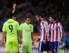 Mario Suarez (2.R) of Club Atletico de Madrid is sent off by referee Gil Manzano during the Copa del Rey Quarter Final Second Leg match between Club Atletico de Madrid and FC Barcelona at Vicente Calderon Stadium on January 28, 2015 in Madrid, Spain.