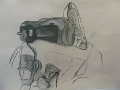 Charcoal & Chalk still-life drawing of shoes.