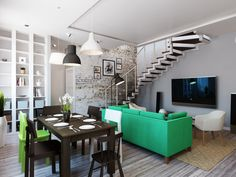dining room area with black wooden dining table and wooden dining chairs beside green sofa and brown carpet on wooden laminate floor: cool and smart designs by boris alexandrov