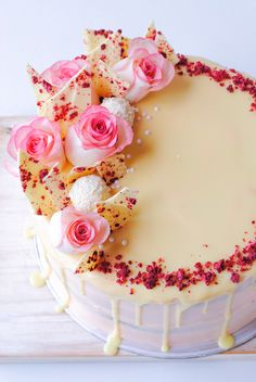 Raspberry, White Chocolate & Rhubarb Layer Cake with drip. Recipe creation and photography by The Hungry Cook
