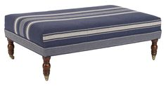 This large striped ottoman has a hardwood frame and plush, comfortable cushioning. Casters on the turned legs allow for easy mobility without damaging your floors. Handcrafted in the USA.