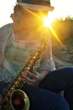[My family's hobby]  My hobby: playing my alto saxophone Camera angle: low angle Camera shot: medium close-up Style in photography: portraiture Technique in style: using the sunlight
