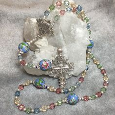 Rosary Pastel, hand painted Paters,  Sterling Silver Cross and center Feminine Cable $129 https://www.etsy.com/listing/236770467/rosary-pastel-hand-painted-paters?ref=shop_home_active_1