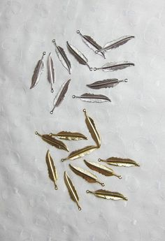 Gold or Silver Feather Charms plated brass 32x7mm by PuddintaneInc http://etsy.me/1sbSc0d via @Etsy #goldfeathercharm #jewelrysupplies #goldfeather #charms #diyjewelry #diycharms