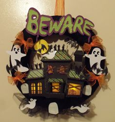Look at this cute wreath Celeste made!  She used svg files from ELMHURST HOLLOW SVG KIT, MONSTER MASH SVG COLLECTION, GOTHIC FLOURISHES SVG COLLECTION, SPOOKY SILHOUETTES SVG COLLECTION and HAUNTED HEMLOCK CARDS KIT.  Beware!!!