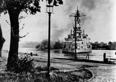"September 1, 1939, 4:45 a.m. German drill ship ""Schleswig-Holstein"" opens fire on the polish bunkers at the Westerplatte, a woody peninsula near Danzig."