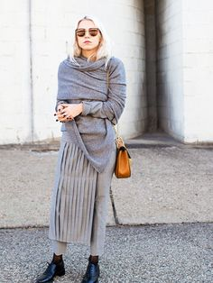 Always Judging stylishly layers in pants, a pleated skirt, and a blanket scarf