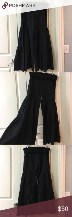 "Black fold over palazzo pants. Black fold over palazzo pants. These are adorable fun flared pants. I paired it with a wrap cardigan with long ties. Fit M/L. I bought these at a boutique in Frisco, TX. From the fold over length is 36.5"". Wearables Pants Wide Leg"