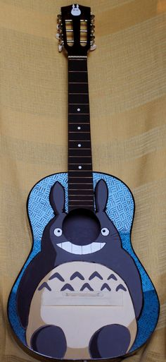 OMG it's  a hand painted totoro guitar. :D