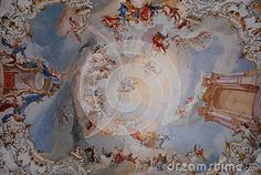 Photo taken inside the famous church of Wieskirche pilgrimage site located in Bavaria (Germany). The picture shows one of the times completely frescoed with images that form the background of the circles representing a cvielo with light white clouds.