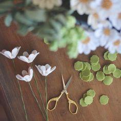 Custom wildflower wedding bouquets being made