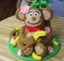 Monkey cake with bananas and pink flowers. could do dinosaur this way, maybe with sugar noodles and a bowl for dinosaur vs. a bowl of spaghetti.