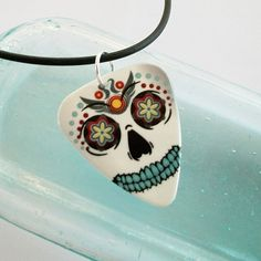 Sweet sugar skull necklace made from a recycled guitar pick by susanwilliamsdesigns.etsy.com  11$    #dteam