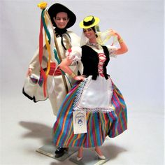 Vintage Canary Islands Spanish souvenir dolls from Spain Woman wears authentic dress, apron, hat, jewelry Man wears white cape, pants, shirt, black hat Self standing Dolls are made of plastic, with hair, hand painted face 9 inches high Good condition, gently owned  International buyers welcome, shipping is automatically combined, overcharges are refunded Priority shipping options are offered 12517