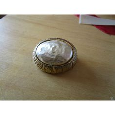 """vintage solid goldtone oval brooch pearlised centre 1.5""""long in good condition"""