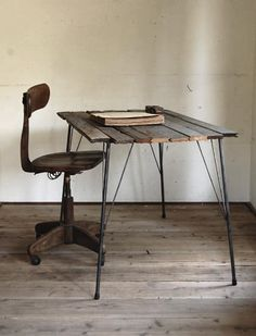 If only we had so much room in our house that we could have an empty room with just a table, a chair,and an old book on it... #IndustrialChair