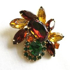 Vintage Verified D&E JULIANA Watermelon, Amber, Topaz and Green Rhinestones Brooch or Pin by MyVintageJewels on Etsy https://www.etsy.com/listing/217880195/vintage-verified-de-juliana-watermelon