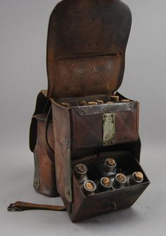 Doctor's Elliot's Patent Leather Saddle Bags : Lot 292 Doctor's Leather Saddlebags The marked Elliot's Patent January 1870 St. Louis MO doctors saddle bag has 24 glass medicine bottles.