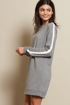 The best of both worlds, this crewneck sweatshirt dress features a cozy fit and sporty stripes along the sleeves.